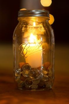 Mason jar lanterns from rusticweddingchic.com