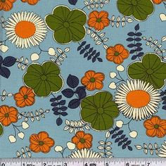 Bold sunflowers are surrounded by wildflowers in this fun floral print. This quilting weight Japanese fabric is 43/44