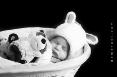 newborn with his toys