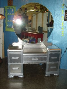 art deco vanity wrapped in aluminum with metal screw trim .This item is…