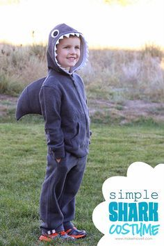 simple shark costume made with sweatshirt and sweat pants...I also saw a trio of costumes recently that was adorable: shark, lifeguard (red shorts + lifeguard shirt) and surfer (swimsuit)!