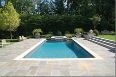 gray Stone Pool Decks In the hopes that my pool research and eventual decisions might help . Backyard Pool Designs, Swimming Pools Backyard, Swimming Pool Designs, Pool Decks, Lap Pools, Indoor Pools, Pool Paving, Backyard Pavers, Rectangle Pool