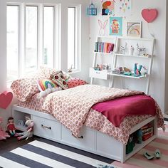 The Land of Nod's White Glaze Topside Storage Bed has four lower drawers that provide tons of out-of-sight storage.  Plus, the footboard and headboard create lots of space for books, toys and more.  It's ideal for small bedrooms, shared bedrooms or anyone looking for an innovative space-saving design.