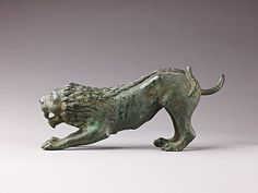 Crouching Lion; ca 5th -3rd c BCE; Culture: Early or middle Roman Republican, probably Etruria; Medium: Bronze