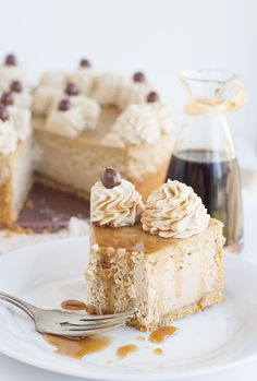 Coffee Cheesecake - creamy coffee cheesecake topped with a coffee whipped cream and chocolate covered espresso beans
