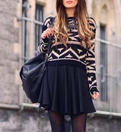 Wear a cropped sweater over a black sundress to make it work for winter. Add tights for warmth.