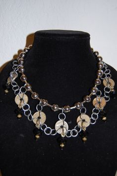 Upcycled vintage coins with black crystals by Menono Designs.