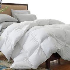 Down-blend comforter in white.Product: Comforter    Construction Material: Cotton cover and down-blend fill