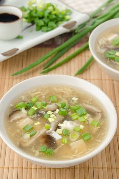 "Soothing Ginger Chicken Soup 1oz dried shiitake mushrooms 3 cups boiling water 3 cloves garlic, minced 1 1/2lbs chicken thighs, cut into chunks 1"" piece of fresh ginger, peeled and sliced thin 2 tablespoons soy sauce 1 teaspoon sugar a pinch of salt 1 teaspoon corn starch 2 tablespoons sliced scallions (green tops only)"
