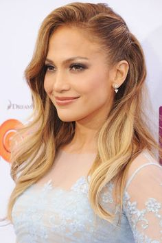 J-Lo looks stunning as always in this pinned side 'd' with an asymmetrical look to it that is sure to turn heads.
