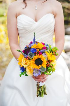 Bright Wildflower Bouquet - Warmth and Happiness: 20 Perfect Sunflower Wedding Bouquet Ideas - EverAfterGuide