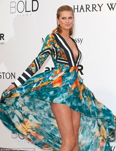 Thigh's the limit: The 22-year-old model eagerly fanned out the double Georgette high-low ...