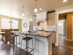 Check out our photo gallery of custom-made luxury homes! We're the only true custom luxury home builders in Utah. Take a look at our gallery of beautiful homes. Custom Home Builders, Custom Homes, White Cupboards, Kitchen Views, Home Kitchens, Bar Stools, Utah, Luxury Homes, Beautiful Homes