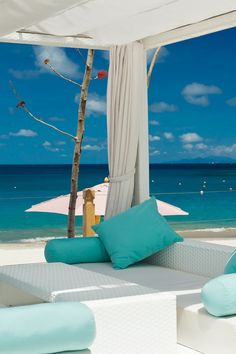 White-and-blue cabanas reflect the hotel's crescent-shaped stretch of Cariblue Beach. #Jetsetter