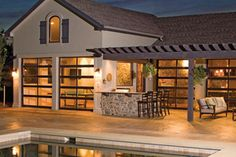 Love the idea of using garage doors on the pool house? Check out the Clopay Avante Collection aluminum and glass garage door for design options. www.clopaydoor.com.