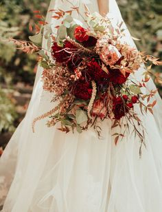 This woodland wedding was inspired by Nature and featured a ceremony in a redwood grove, a pampas grass covered reception, rich red wedding flowers and a romantic tulle wedding dress. #gws #greenweddingshoes #naturewedding #forestwedding #woodlandwedding