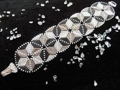 """""""Beadwork"""" magazine for June 2011 came the instructions for this bracelet, that about 30 individual triangles that has been stitched. This produces the optical illusion, depending on which circle the eye focuses.  Length with folding magnetic closure: 19 cm."""