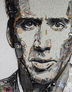 Clean up: Bad boy Nicholas Cage of course has a vodka bottle, wine and shot glasses and a gun as part of his portrait
