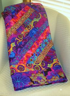 The SIZZLER--Purple, Blue, Magenta & Gold Kaffe Fassett Fabrics SIZZLE in this stunning quilt
