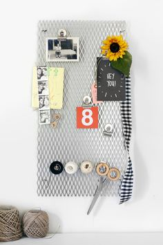 DIY steel grate memo board. Click through for material sources.
