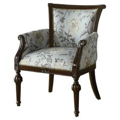 Nailhead-trimmed arm chair with floral upholstery and fluted legs.  Product: Arm chairConstruction Material: Wood