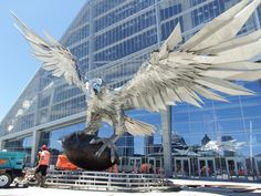 The largest free-standing bird sculpture in the world is about to rise up in front of the Atlanta Falcons' new home: Mercedes-Benz Stadium.