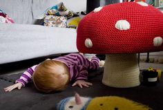 Red and white spotted crochet toadstool. Anne-Claire Petit mushroom pouf.