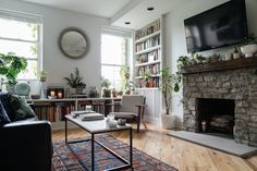 """When Garrett Munce and Adam Rathe, both magazine editors residing in Brooklyn, needed a """"designer's touch"""" for their 1-bedroom apartment, they knew that Homepolish's Single Day Session was the answer. After a consultation, designer Ariel Feldman took their apartment to """"home sweet home"""" in the matter of 3 hours."""