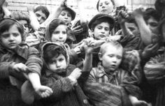 Some of the 600 children who had survived the Auschwitz II-Birkenau camp show their tattooed identification numbers upon liberation.