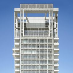 """Richard Meier has finished work on his first project in Israel, a residential tower covered in a """"veil"""" of white louvres that ensure the building is in keeping with its Bauhaus-era neighbours in Tel Aviv's White City. Find out more on dezeen.com/architecture #architecture #Bauhaus #tower #TelAviv Photograph by Roland Halbe."""