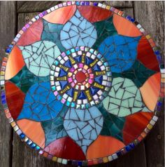 Mosaic stepping stone by Laura Sinkins - Hespeler Homestead