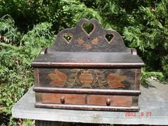 $ 6200.00 Pennsylvania German ( Most Likely Lancaster County) , Paint Decorated ,100% Pure ,Hanging ,2 Drawer Lidded Candle Box, Is believed to the Finest known Surviving Example from the Early to Mid 1700's. The Pot and Flower Decoration is very reminecient Of the South East Pennsylvania German Blanket Chests From this Extremely Early Period. The Wood is American Walnut ,and the Case ,and Drawers are Well Dovetail- ~♥~.