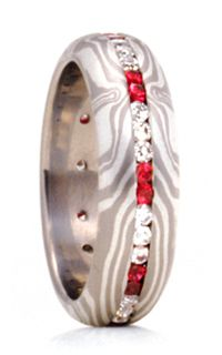"""George Sawyer symmetry mokume gane wedding band in """"J"""" metal combination gray gold etched sterling silver) with eternal channel of rubies white diamonds. Available in other precious colored stones diamonds. Ruby Eternity Ring, White Diamonds, Anniversary Rings, Precious Metals, Wedding Bands, Gemstone Rings, Channel, Fine Jewelry, Stones"""