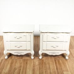 This pair of french provincial nightstands are featured in a solid wood with a fresh white paint finish. These end tables have 2 drawers, carved accents and curved trim. Cottage chic bed side tables with plenty of storage! #cottagechic #dressers #nightstand #sandiegovintage #vintagefurniture