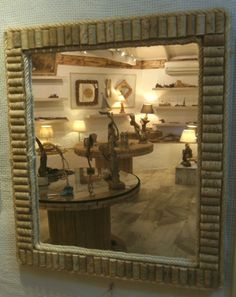 Upcycled Wine Corks Mirror - An eye-catching mirror framed by wine corks and rope edged on the inner and outer sides.  This is a decent sized mirror, suitable for living room, bedroom or bathroom.  Two wall hangings have been attached allowing the mirror to be displayed either vertically or horizontally.