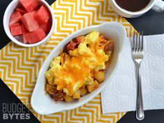 Country Breakfast Bowls   Potatoes, olive oil, paprika, garlic powder, salt, pepper, eggs, butter, salsa, shredded cheddar.
