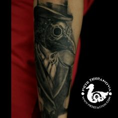 Black and gray healed plague doctor tattoo
