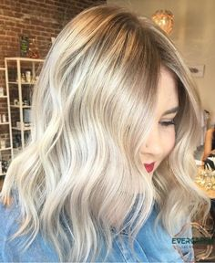 Blonde babylights balayage color medium length hair waves curls