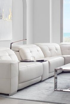 Rethink the power reclining sectional. Our Reva collection gives this living room staple a modern upgrade, upholstered in premium leather with a built-in LED light and center console. Optional add-ons include an armrest table and light. See more from this CITY Furniture exclusive right here. Arm Rest Table, Modular Table, Living Room Goals, Reclining Sectional, Bedding Basics, Center Console, Furniture Assembly, City Furniture, Leather Sectional