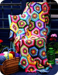 I may just have to put a hexagon blanket on my project list. Love the bright colors. So lovely. What a fun blanket.