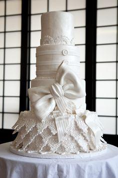 Amazing winter wonderland cake. I love the oversized pow and whimsical fondant details!