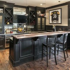 """Home sports bars can often overdo it on the memorabilia, but this one is a great example of how having """"just enough"""" allows the beauty of the bar to shine through. #housetrends Find even more at http://www.housetrends.com/ideas/bar-wine-storage"""