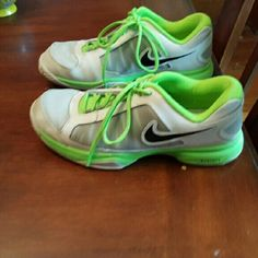 TONIGHT ONLY PRICE DROP from $30! EUC Nike Shoes Gently used white and green  Nike tennis shoes.  They are in terrific shape with just a little darkening on the toes.  It is hard to see on the sides but they have black zig zags under mesh behind the swoosh...the panels aren't discoloured! Nike Shoes Athletic Shoes