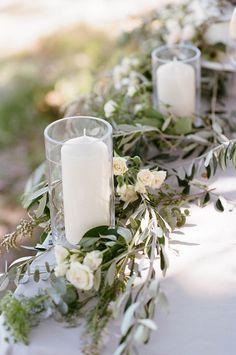 Neutral olive leaf and rose table runner with elegant white pillar candles | Josie Richardson Photography
