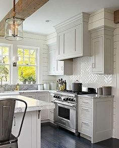 Light Gray Shaker Kitchen Cabinets with Glossy White Herringbone Tile Backsplash - Transitional - Kitchen White herringbone backsplash, exposed beam, pendant light, cabinetry Grey Shaker Kitchen, Classic Kitchen, Farmhouse Kitchen Cabinets, Modern Farmhouse Kitchens, Kitchen Cabinet Design, Kitchen Redo, New Kitchen, Home Kitchens, Fresh Farmhouse