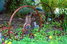 March 30th 91/365 . . . Old bike rims turn garden decor | Flickr - Photo Sharing!