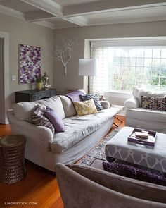 GB Love the ottom/fabric covered coffee table...PlumArtworkLivingroom