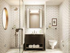 Sullivan Hotel, contemporary white bathroom, subway tile floor to ceiling #subwaytile #porcelaintile #interiordesign #commercialdesign #hospitalitydesign