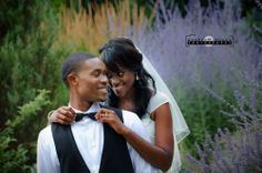 Humber Arboretum Toronto Wedding Photography, lavender flowers in background, bride fixing the grooms tie.