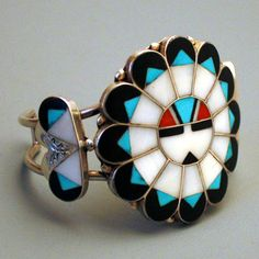 Era: 1970s Material: sterling silver, turquoise, coral, mother of pearl, onyx Dimensions: face of bracelet measures 5x5cm, inside circumference 16cm Marks: hand inscribed Marie Qualo Condition: excellent Weight: 44.4 grams Total Shipping Weight: 7oz Laeclectica's Shop: http://www.laeclectica.etsy.com Necklaces: http://etsy.me/1Fig71V Rings: http://etsy.me/1FigbyG Bracelets: http://etsy.me/1Htwni3 Brooches: http://etsy.me/1...